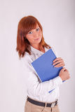 A young woman is carrying a book Royalty Free Stock Image