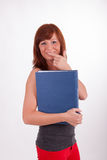 A young woman is carrying a book Royalty Free Stock Images