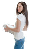 Young woman carrying books Royalty Free Stock Photos