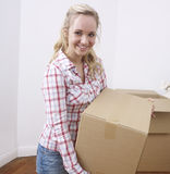 Young woman carrying box Royalty Free Stock Photos