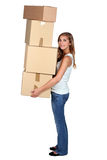 Young woman carrying boxes. Young woman carrying four large packing boxes Royalty Free Stock Image