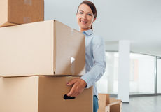 Young woman carrying carton boxes Stock Images