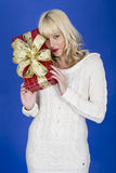 Young Woman Carrying Christmas Presents Royalty Free Stock Photography