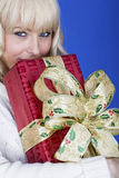 Young Woman Carrying Christmas Presents Stock Image