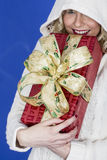 Young Woman Carrying Christmas Presents Stock Photo