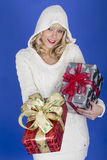 Young Woman Carrying Christmas Presents Royalty Free Stock Images