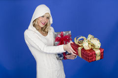 Young Woman Carrying Christmas Presents Stock Photography