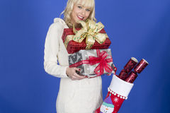 Young Woman Carrying Christmas Presents Stock Photos