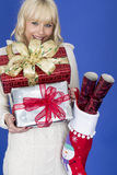 Young Woman Carrying Christmas Presents Royalty Free Stock Photos