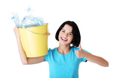 Woman carrying a container with empty recyclable plastic. Stock Photos