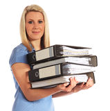 Young woman carrying documents. Attractive young woman carrying documents. All on white background royalty free stock images