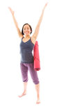 Young woman carrying exercise mat celebrating success Royalty Free Stock Image