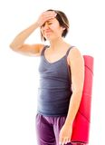 Young woman carrying exercise mat with hands on head Stock Photography