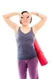 Young woman carrying exercise mat with her hands around her eyes Stock Photos