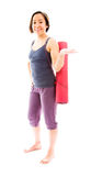 Young woman carrying exercise mat presenting Royalty Free Stock Images