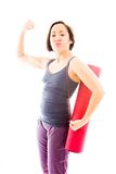 Young woman carrying exercise mat showing off her muscle Royalty Free Stock Images