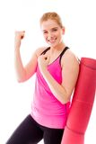 Young woman carrying exercising mat and celebrating success Stock Image