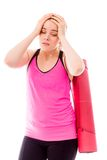 Young woman carrying exercising mat looking depressed Royalty Free Stock Photo