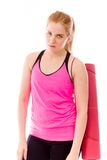 Young woman carrying exercising mat and looking serious Stock Photos