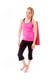 Young woman carrying exercising mat and looking serious Stock Images