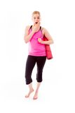 Young woman carrying exercising mat looking shocked Stock Images