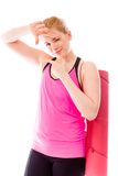 Young woman carrying exercising mat making frame with fingers Royalty Free Stock Images