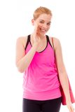 Young woman carrying exercising mat whispering Royalty Free Stock Images