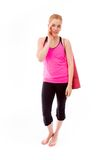 Young woman carrying exercising mat whispering Stock Photo