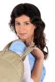 Young woman carrying a handbag Royalty Free Stock Image
