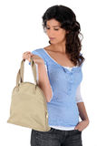 Young woman carrying handbag Stock Photography