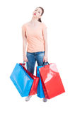 Young woman carrying heavy shopping bags feeling tired and exhau Royalty Free Stock Photos
