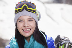 Young Woman Carrying Her Skis Stock Images