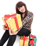 Young woman carrying a lot of gifts Stock Photo