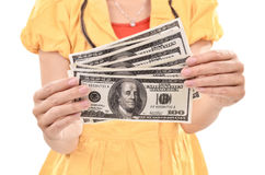 Young woman carrying a lot of money dollars Stock Photography