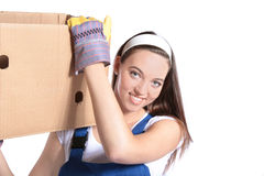 Young woman carrying moving box Stock Image