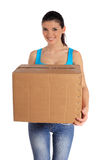 Young woman carrying a moving box Stock Image
