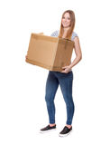 Young woman carrying moving box Stock Photos