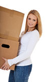 Young woman carrying moving boxes Stock Image