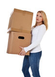 Young woman carrying moving boxes Royalty Free Stock Image