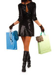 Young woman carrying shopping bag. Isolated on white Stock Photo