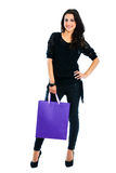 Young woman carrying shopping bag. Isolated on white background Royalty Free Stock Photo