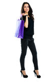 Young woman carrying shopping bag. Isolated on white background Stock Photo