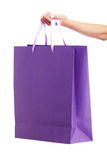Young woman carrying shopping bag. Isolated on white background Stock Images