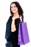Young woman carrying shopping bag. Isolated on white background Stock Photography