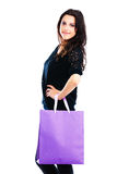 Young woman carrying shopping bag. Isolated on white background Stock Photos