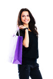 Young woman carrying shopping bag Stock Images