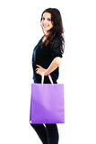 Young woman carrying shopping bag. Isolated on white background Royalty Free Stock Images
