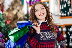 Young Woman Carrying Shopping Bags In Christmas Stock Images