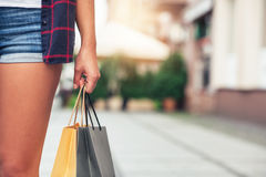 Young woman carrying shopping bags in the city Stock Photography