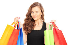 Young woman carrying shopping bags Stock Images
